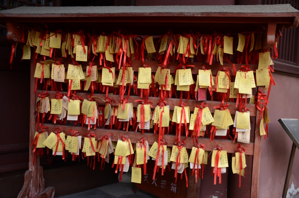 Hundreds of blessing cards hang on shelves in front of Dacheng Hall in Shanghais Confucian Temple. 