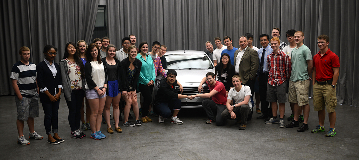 Students pose with Changan Ford CEO Marin Burela