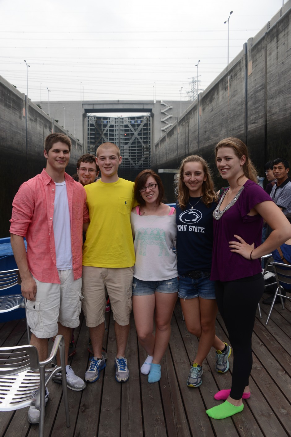 Students pose in front of the first ship lock to the Three Gorges Dam. The dam features a five-level double ship lock — some more than a mile long — designed to raise or lower a ship a total vertical distance of 370 feet. It took the students' cruise ship three hours to traverse all five lock gates. (Photo credit: Curtis Chan)
