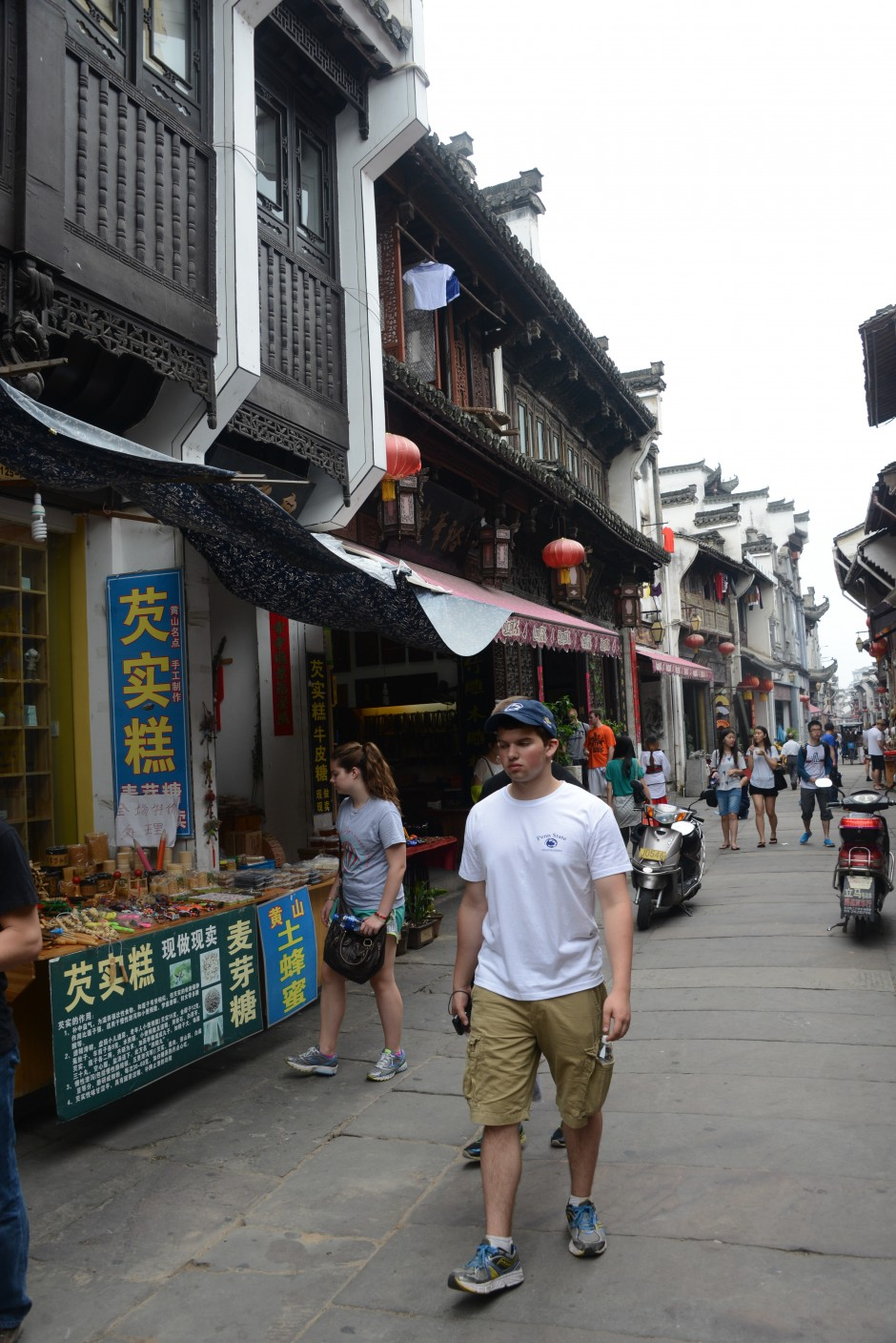 Students shop at Lao Jie, or Old Street, in Tuangxi in Huangshan. Many of the restored houses date back to the Ming Dynasty and now serve as souvenir shops, antique dealers and restaurants. (Photo credit: Curtis Chan)