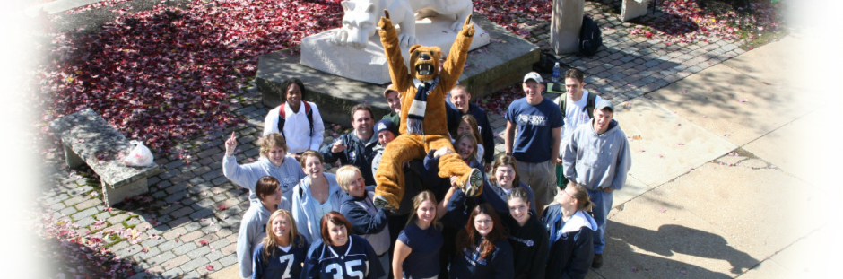 aerial view of Penn State students holding up Nittany Lion Mascot
