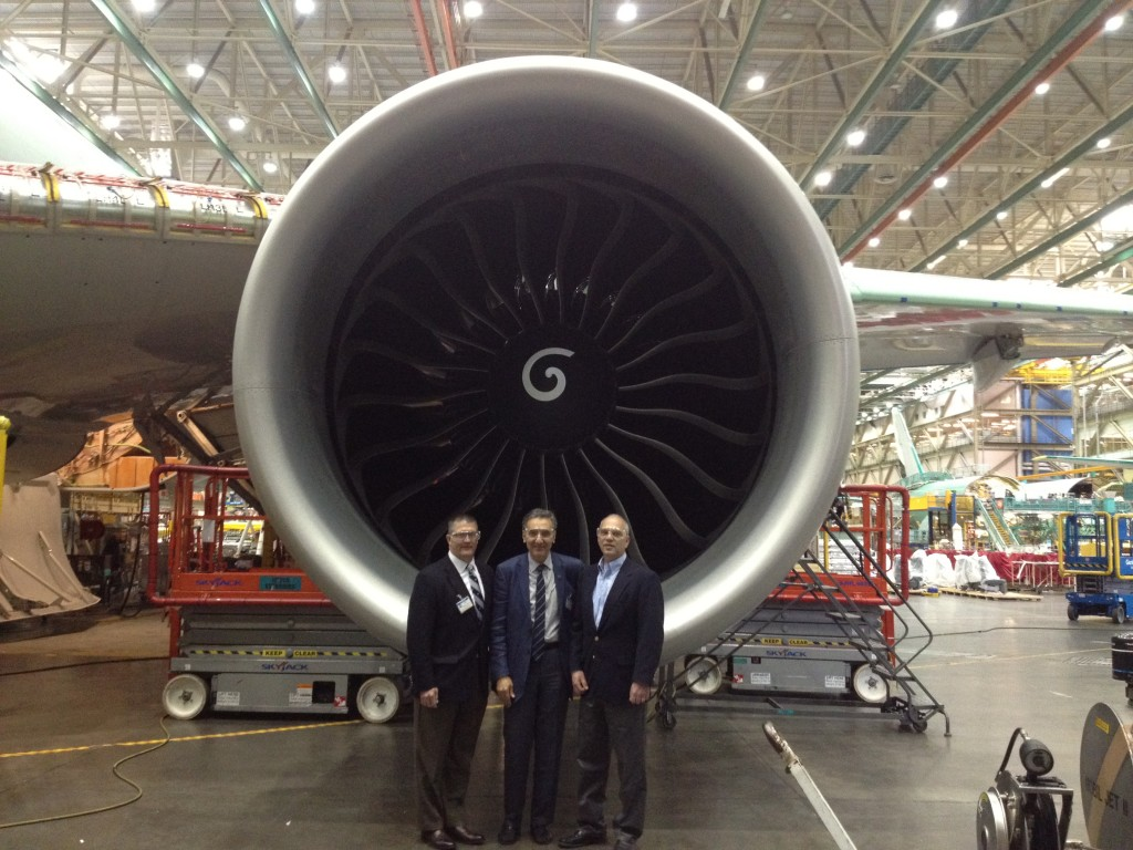 Mark Sharer, director of development in the College of Engineering, left; Amr Elnashai, dean of engineering; and Jeffrey Croft, Boeing's director of engineering for Systems LCPT-787 Program, stand in front of an engine for the company's 787 Dreamliner aircraft.