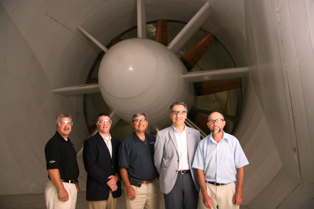 Pictured are James Folmar, 1986 graduate and director of Boeing's H-47 operations, left; Mark Sharer, director of development for the College of Engineering; Steven Glusman, 1981 graduate and director of advanced vertical lift; Dean Amr Elnashai; and Bill Grauer, manager of the wind tunnel facility the group was photographed at.