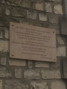 A plaque on the cemetery wall honors the children deported from France, one of many such plaques we saw throughout the city.