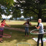 female students hula hooping