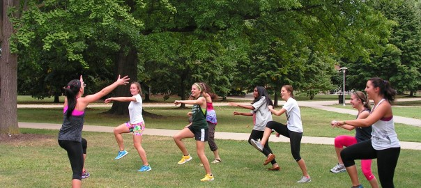female student leading students in exercise