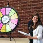 female student with prize wheel