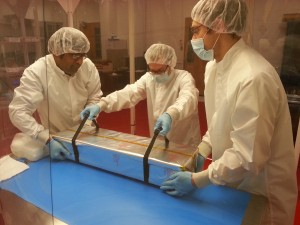 Suvrath, Eric and Ryan lift the grating onto the table for inspection.  Not an easy lift!