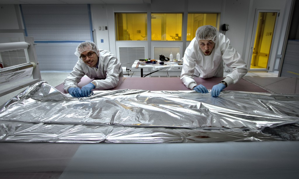 <b>MLI blanket making</b> - The blankets are assembled in a clean-room to reduce particulates, which are unfavorable for vacuum pump-down.