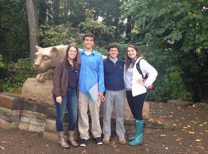 Envoys with Prospective Students at the Nittany Lion Shrine