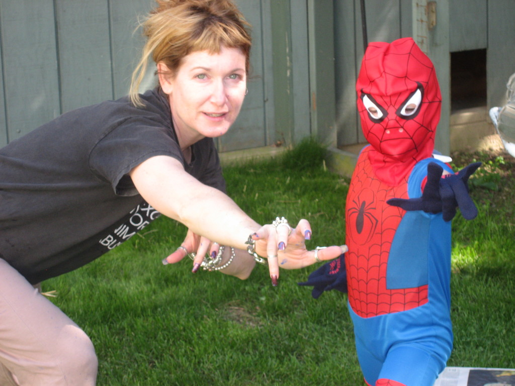 "Practicing my super-hero moves and ""don't mess with me"" glare with my little boy."