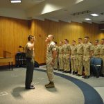 Officer Candidate Redmond takes the Oath of Office upon his promotion from Staff Sergeant to Gunnery Sergeant.