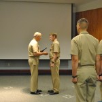 Officer Candidate Madera receives a Navy Commendation Award during Battalion Leadership Lab.