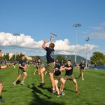 Midshipmen play ultimate frisbee during Battalion PT.