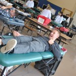 Midshipmen participate in the 2014 Red Cross Blood Drive.