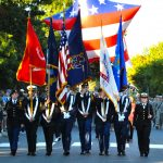 The Joint Service ROTC Color Guard marches during the 2014 Homecoming Parade.
