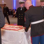 Sergeant Roger Kerstetter cutting the birthday cake.