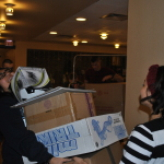 Midshipmen move boxes of toys in support of Toys for Tots.
