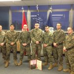 SSgt McCole (center) poses with other MECEP's following his promotion.