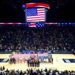 ROTC midshipmen and cadets hold the flag during the National Anthem at the Penn State Men's Basketball Military Appreciation game.