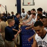 Penn State Men's Basketball players hand out coins to midshipmen and cadets following their Military Appreciation game.