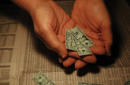 hand holding small dollars