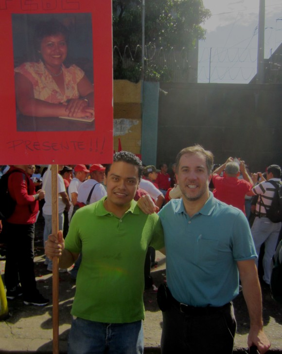 Mark Anner and Jobany Valesquez, the son of Febe Elizabeth Valesquez, who died in a the same bombing in El Salvador that wounded Anner. Jobany was six months old at the time his mother was killed. The photo was taken in front of the exact spot where the bombing occurred on the 25th anniversary of the bombing. A series of events were planned that day to celebrate the lives of those who died.