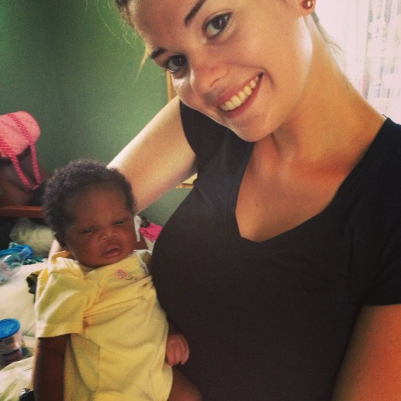 Cara with a baby whose mother participated in her Moringa Tree research project.  Photo was taken by Kaitrin Rodgers.