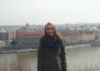 Amanda in front of the Czech cityscape