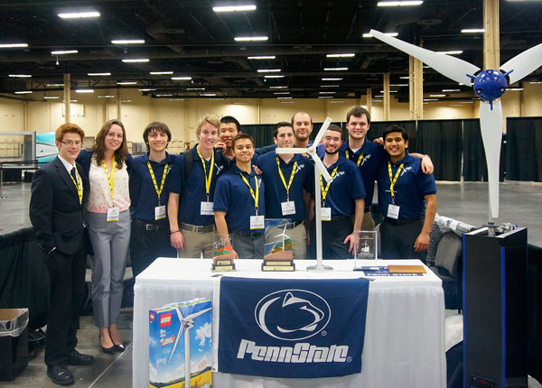 Group of Penn State students posing with awards.