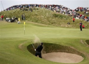 Tiger Woods plays from a bunker towards the fifth green during the second round of the British Open Golf championship, at the Turnberry golf course, Scotland, Friday, July 17, 2009. (AP Photo/Peter Morrison) http://www.masslive.com/sports/index.ssf/2009/07/american_steve_marino_a_surpri.html