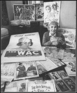 Alice K. Marshall surrounded by posters and postcards from her vast collection of women's history materials.