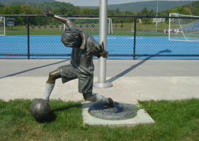 Untitled (Child Kicking Soccer Ball)