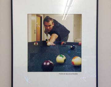 Untitled (student playing pool)