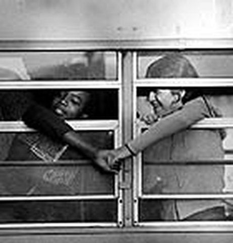 Students hold hands during the second stage of Boston's integration efforts (image from NPR, 2004)
