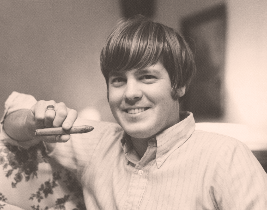 Dave in college at Colgate, holding a cigar