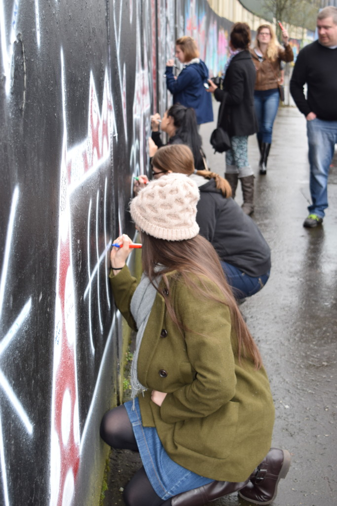 Penn State students writing messages of peace for the Northern Ireland community on one of the many Peace Walls in the country.