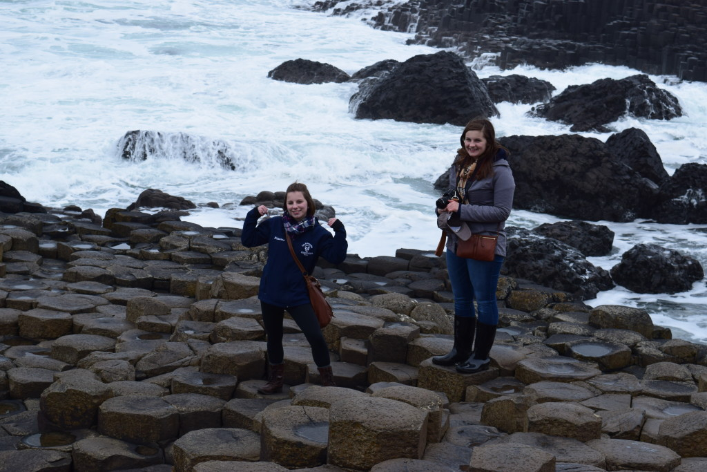 Two students exploring the unique natural landscape at Giant's Causeway.