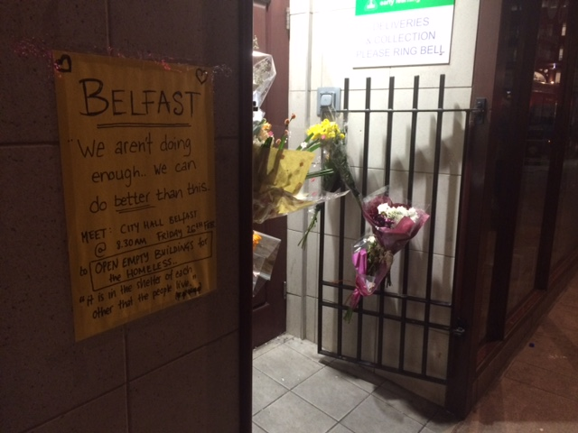 A sign posted outside of an area where a person died from sleeping on the streets in Belfast, Ireland in mid-February.