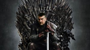 Pat sitting on Game of Thrones throne