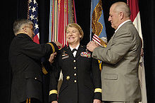 Dunwoody is pinned with her four stars by Army Chief of Staff General Casey and her husband Craig Brotchie.
