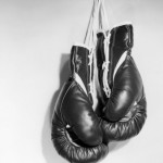 ewing-galloway-boxing-gloves-hanging-on-the-wall-150x150