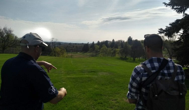 Mark Beatty on left, John on right overlooking the former orchard location on campus.