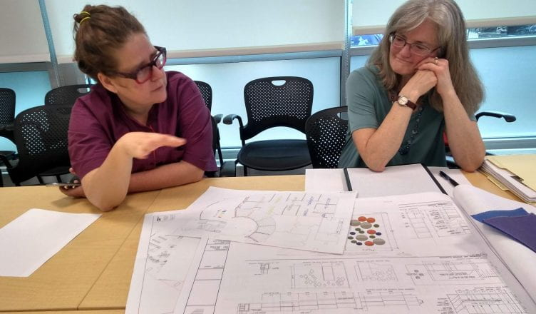 Tamara Gayer and architect Kathy Poissant meet to review site plans.