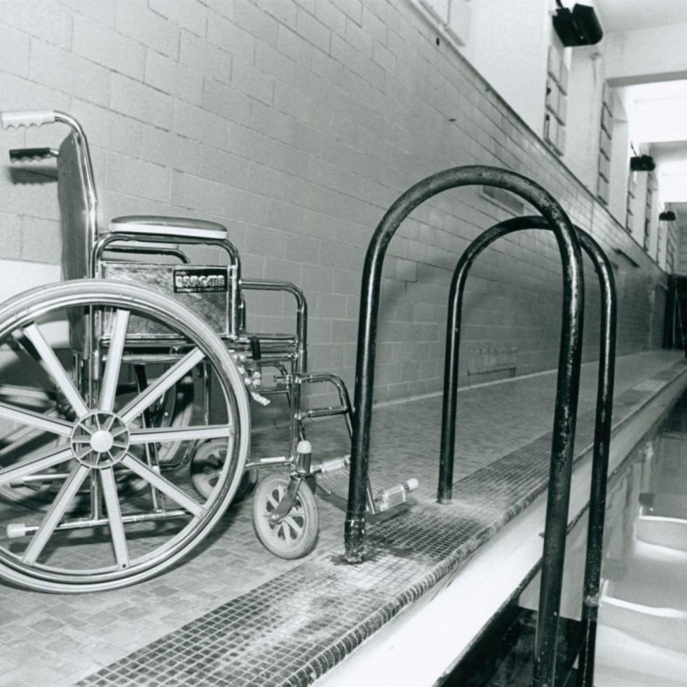 Wheelchair at swimming pool from Physical Plant series, Greg Grieco photographs