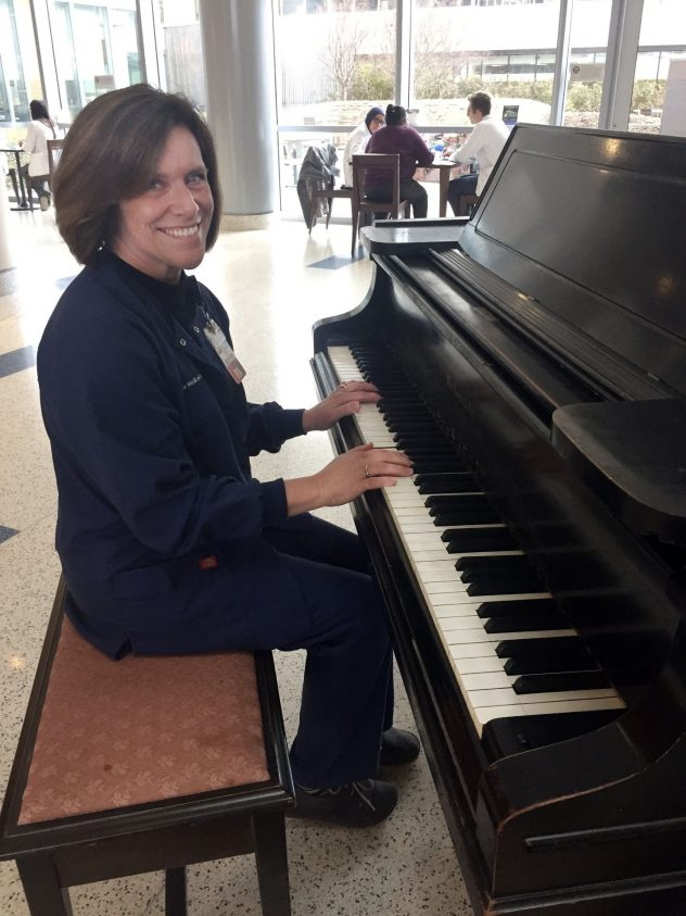 Cheryl Foelker playing the piano in the Main Entrance Lobby of the Penn State Milton S. Hershey Medical Center