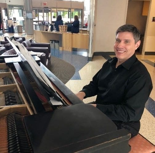 Bryan Herber playing the piano in the Main Entrance Lobby