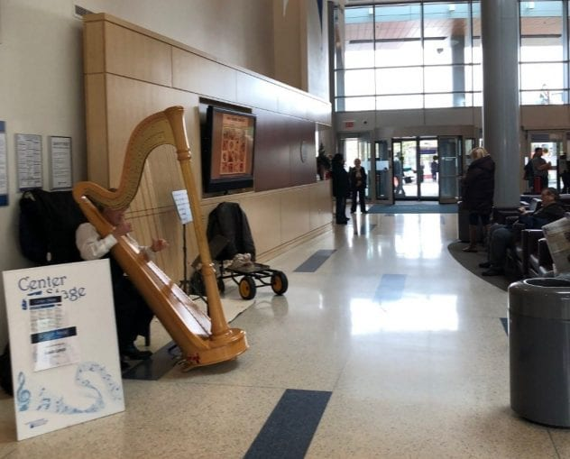 Louis Lynch playing the harp in the Main Entrance Lobby