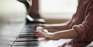 Close up of girl's hands on piano