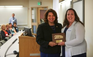 Lauren Thumm Saxton, president of the Nursing Alumni Society (R), presents the 2014 recipient of the Novosel Award, Valerie K. Sabol (L) with her award at the Nursing Alumni Homecoming Brunch in October 2014.